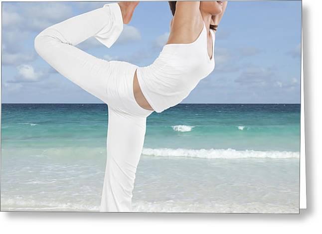 Woman doing yoga on the beach Greeting Card by Setsiri Silapasuwanchai
