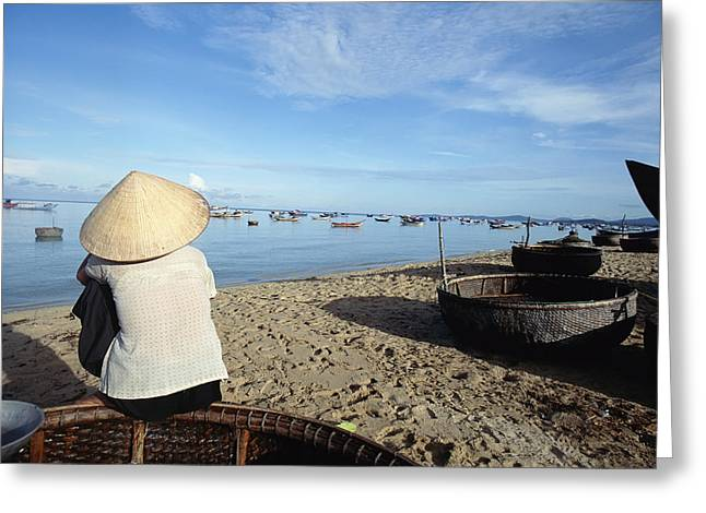 Woman In Conical Hat Sitting On Boat On Greeting Card by Axiom Photographic