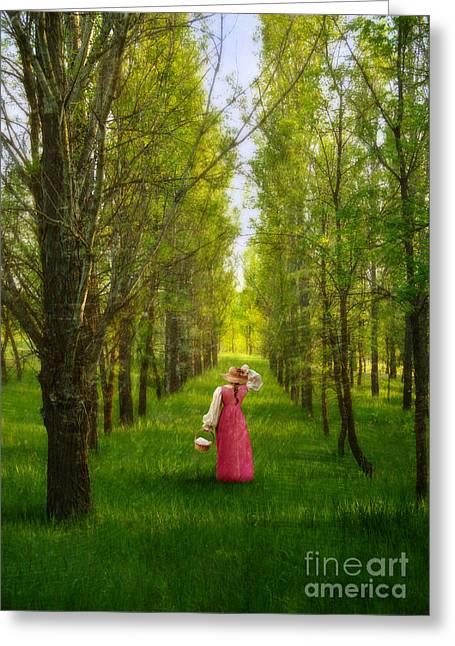 Woman In Vintage Pink Dress Walking Through Woods Greeting Card by Jill Battaglia