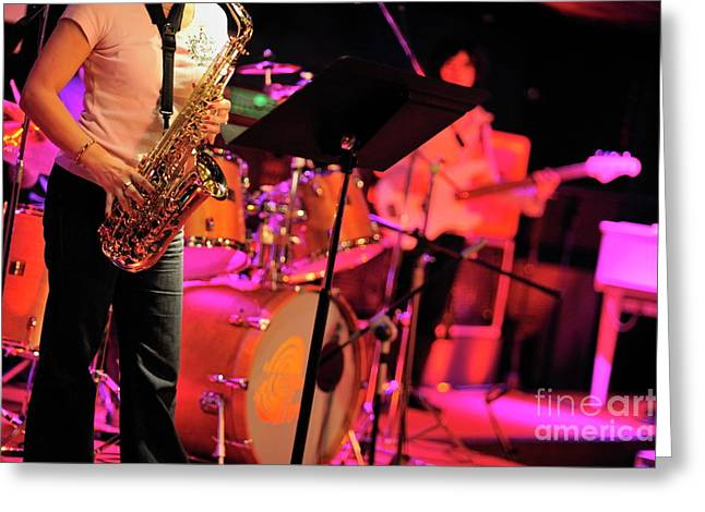 Sami Sarkis Greeting Cards - Woman playing saxophone on stage with her band Greeting Card by Sami Sarkis