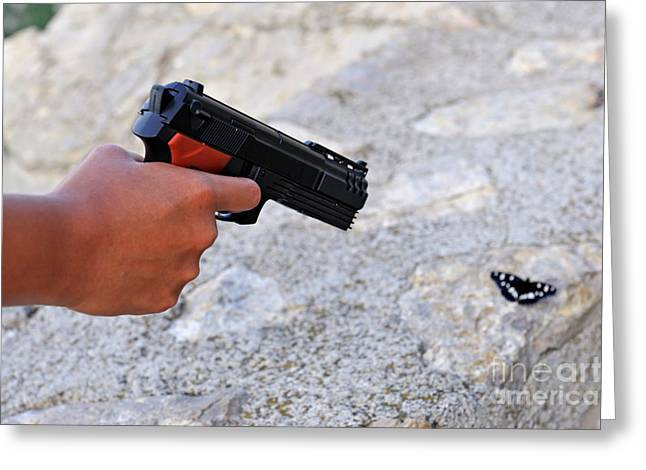 Mid Adult Women Greeting Cards - Woman pointing a toy gun on butterfly Greeting Card by Sami Sarkis