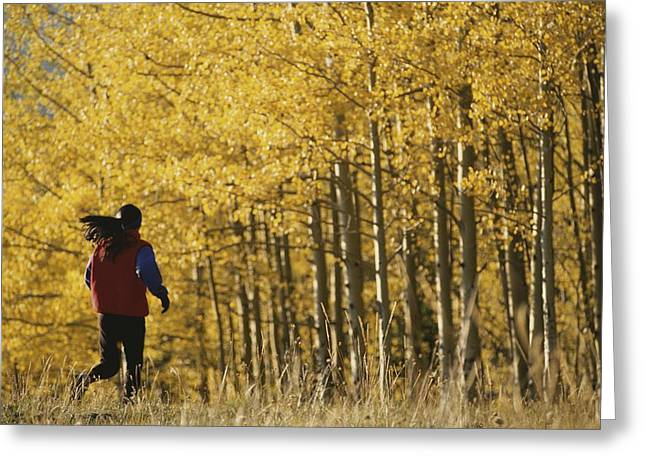 Woodland Scenes Greeting Cards - Woman Running In Field By Aspen Trees Greeting Card by Dugald Bremner Studio