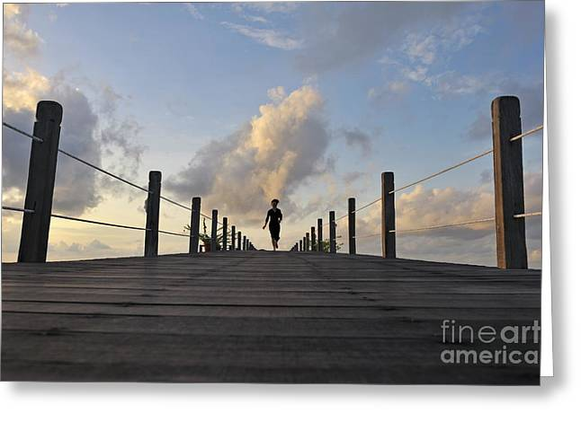 Women Only Greeting Cards - Woman running on wooden jetty at sunrise Greeting Card by Sami Sarkis