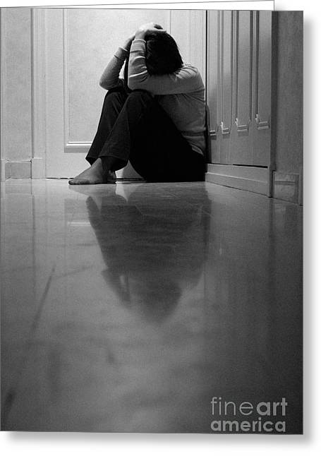 Distraught Greeting Cards - Woman sitting in corridor with head in hands Greeting Card by Sami Sarkis