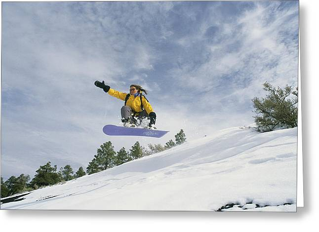 Woman Snowboarding On The Cinder Cone Greeting Card by Kate Thompson
