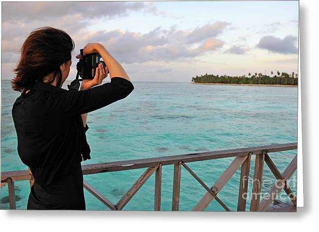 Women Only Greeting Cards - Woman taking a photograph of a tropical island Greeting Card by Sami Sarkis