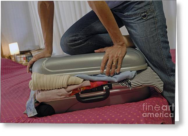 Women Only Greeting Cards - Woman trying to close overflowed suitcase on bed Greeting Card by Sami Sarkis