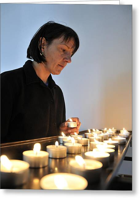 Woman With Candles In Church Greeting Card by Matthias Hauser