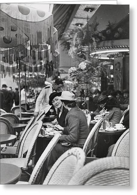 Mid Adult Women Greeting Cards - Women Relaxing At A Sidewalk Cafe Greeting Card by Maynard Owen Williams