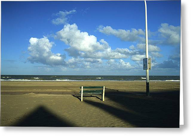 Outdoors Greeting Cards - Wooden bench in front of ocean.Deauville. France Greeting Card by Bernard Jaubert
