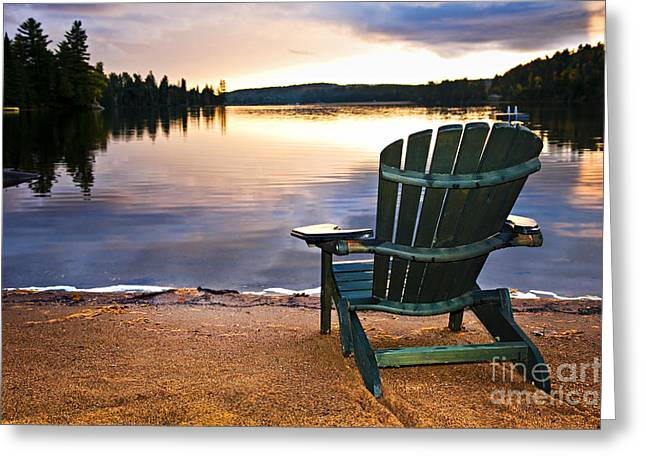 Ontario - Canada Greeting Cards - Wooden chair at sunset on beach Greeting Card by Elena Elisseeva