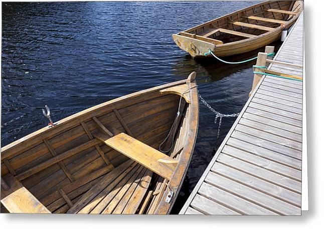Water Vessels Greeting Cards - Wooden Rowing Boats Moored To A Wooden Greeting Card by Jaak Nilson