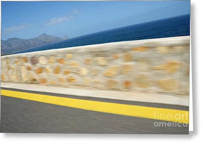 Yellow Line Greeting Cards - Yellow line on a coastal road by sea Greeting Card by Sami Sarkis