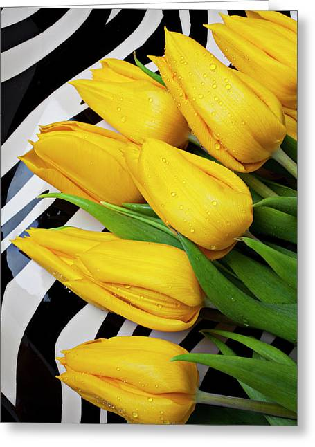 Dew Greeting Cards - Yellow tulips on striped plate Greeting Card by Garry Gay