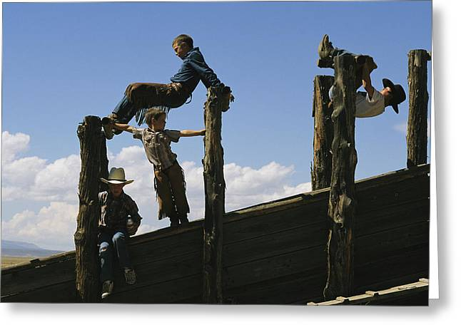 Steen Greeting Cards - Young Cowboys Playing On A Cattle Chute Greeting Card by Melissa Farlow