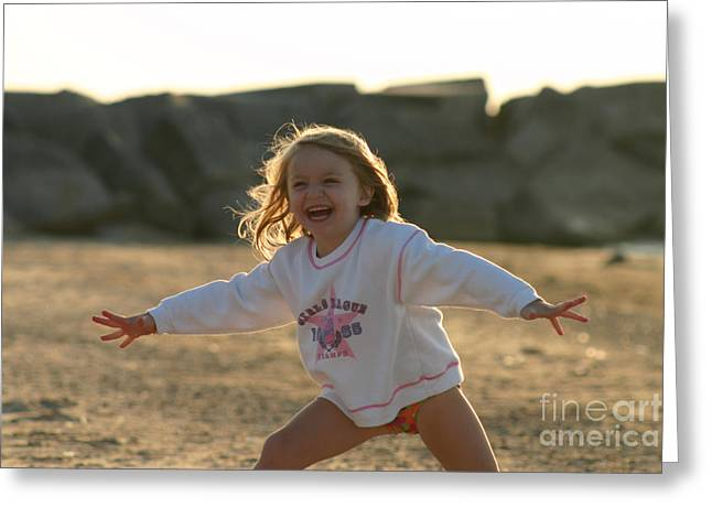 Dancing Girl Greeting Cards - Young girl laughing at the beach Greeting Card by Christopher Purcell