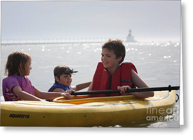 Open Ocean Kayaks Greeting Cards - Young kids playing on a kayak Greeting Card by Christopher Purcell