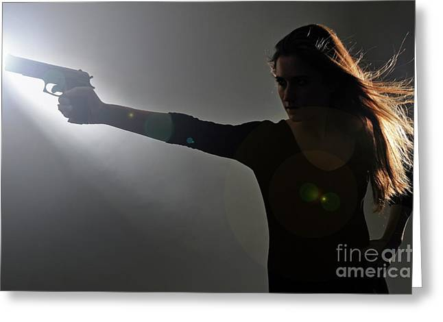 Hand On Waist Greeting Cards - Young woman holding gun Greeting Card by Sami Sarkis