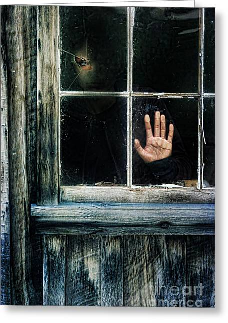 Left Alone Greeting Cards - Young Woman Looking Through Hole in Window Greeting Card by Jill Battaglia