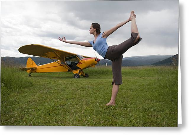 Jogging Greeting Cards - Young Woman Practicing Yoga By An Greeting Card by Pete Mcbride
