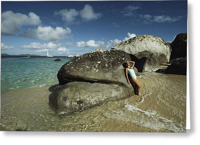 Beach Model Greeting Cards - Young Woman Resting Against A Rock Greeting Card by Bill Curtsinger