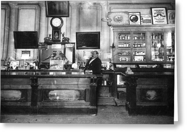 Saloons Greeting Cards -  Bartender In Saloon Circa 1900 Black White 1900s Greeting Card by Mark Goebel