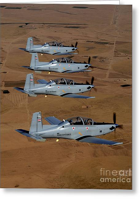 Iraq Greeting Cards - A Formation Of Iraqi Air Force T-6 Greeting Card by Stocktrek Images
