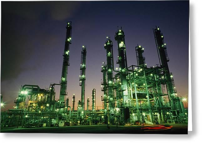 An Oil Refinery At Dusk Greeting Card by Lynn Johnson