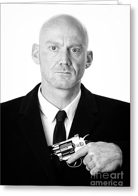 Henchman Photographs Greeting Cards - Bald Headed Man Wearing Heavy Black Overcoat Showing Revolver In Inside Pocket  Greeting Card by Joe Fox