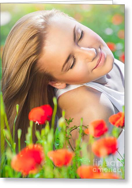 Flower Blossom Greeting Cards - Beautiful woman on poppy flower field Greeting Card by Anna Omelchenko