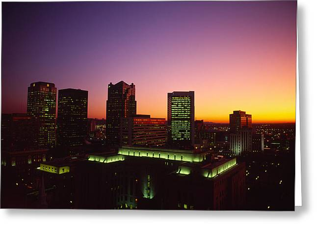 Evening Scenes Greeting Cards - Buildings In A City At Dusk Greeting Card by Panoramic Images