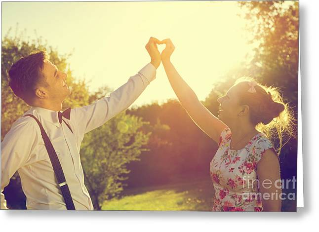 Couple In Love Making A Heart Shape With Their Hands In Sunshine Greeting Card by Michal Bednarek