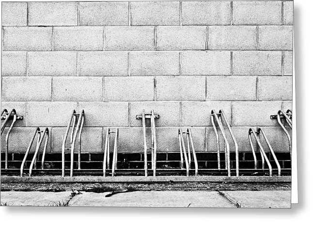 Steel. Grass Greeting Cards - Cycle racks Greeting Card by Tom Gowanlock
