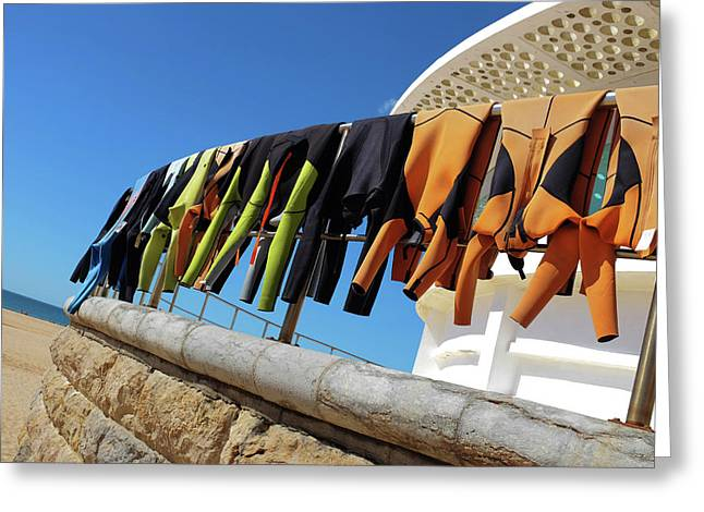 Drying Wet Suits Greeting Card by Carlos Caetano