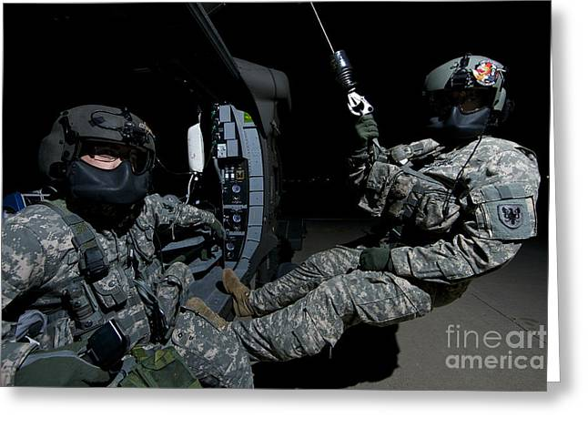 Night Angel Greeting Cards - Flight Medics Practice With The Uh-60 Greeting Card by Terry Moore