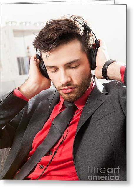 Lifestyle Greeting Cards - Man in suit listening to music with headphones Greeting Card by Wolfgang Steiner