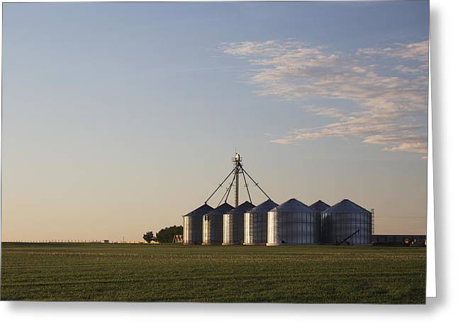 Grain Bin Greeting Cards - Metal Grain Bins Reflecting Sunrise Greeting Card by Michael Interisano