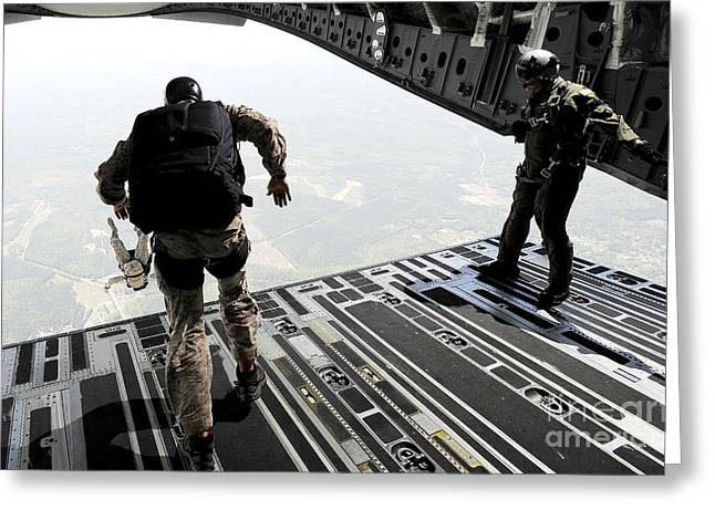Navy Seals Jump From The Ramp Of A C-17 Greeting Card by Stocktrek Images