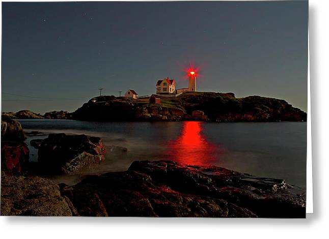 Nubble Lighthouse Lit By The Full Moon Greeting Card by John Vose