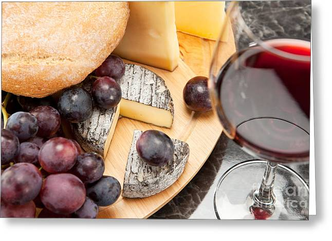 Alcohol Greeting Cards - Red wine with wine grapes cheese plate and bread Greeting Card by Wolfgang Steiner