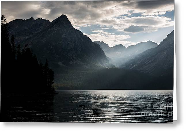 Reflecting Water Greeting Cards - Sunlight Breaking Through Clouds Greeting Card by Mike Cavaroc