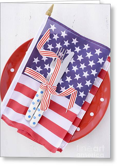 American Independance Greeting Cards - USA party table place setting with flag on white wood table.  Greeting Card by Milleflore Images