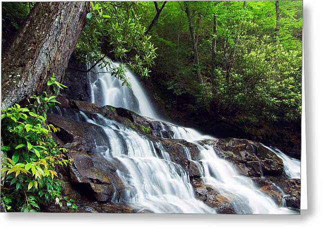 Rugged Cliffs Greeting Cards - Water Cascading Over Rocky Cliffs Greeting Card by Panoramic Images