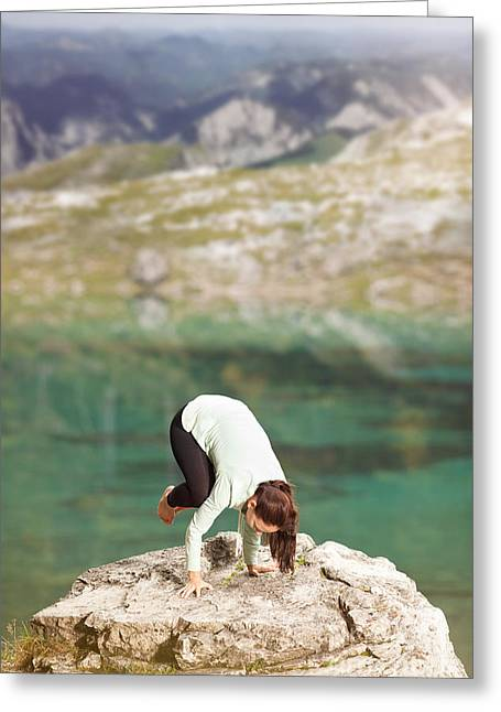 Inner Self Photographs Greeting Cards - Woman doing yoga on a rock on the lake shore Greeting Card by Wolfgang Steiner