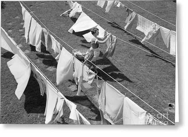 Woman Hanging Laundry, C.1950s Greeting Card by Debrocke/ClassicStock