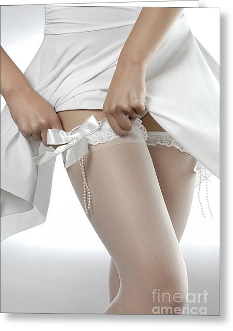 Sexiness Greeting Cards - Woman Putting On White Stockings Greeting Card by Oleksiy Maksymenko