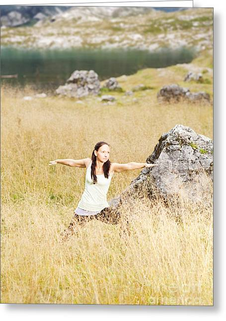 Human Greeting Cards - Yoga poses in high grass in front of a mountain lake in the Alps Greeting Card by Wolfgang Steiner
