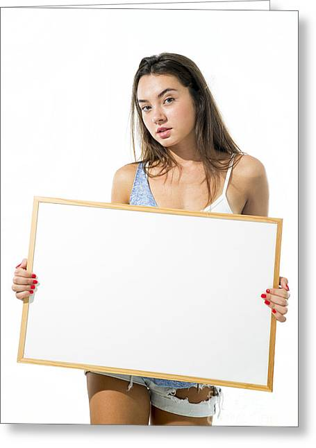 Cut-outs Greeting Cards - Young model hold a blank whiteboard Greeting Card by PhotoStock-Israel