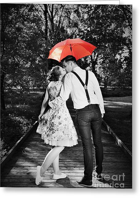 People Greeting Cards - Young romantic couple in love flirting in rain Greeting Card by Michal Bednarek