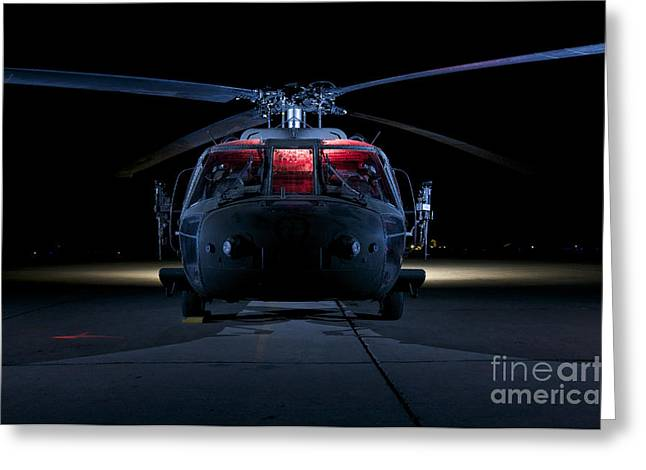 Night Hawk Greeting Cards - A Uh-60 Black Hawk Helicopter Lit Greeting Card by Terry Moore